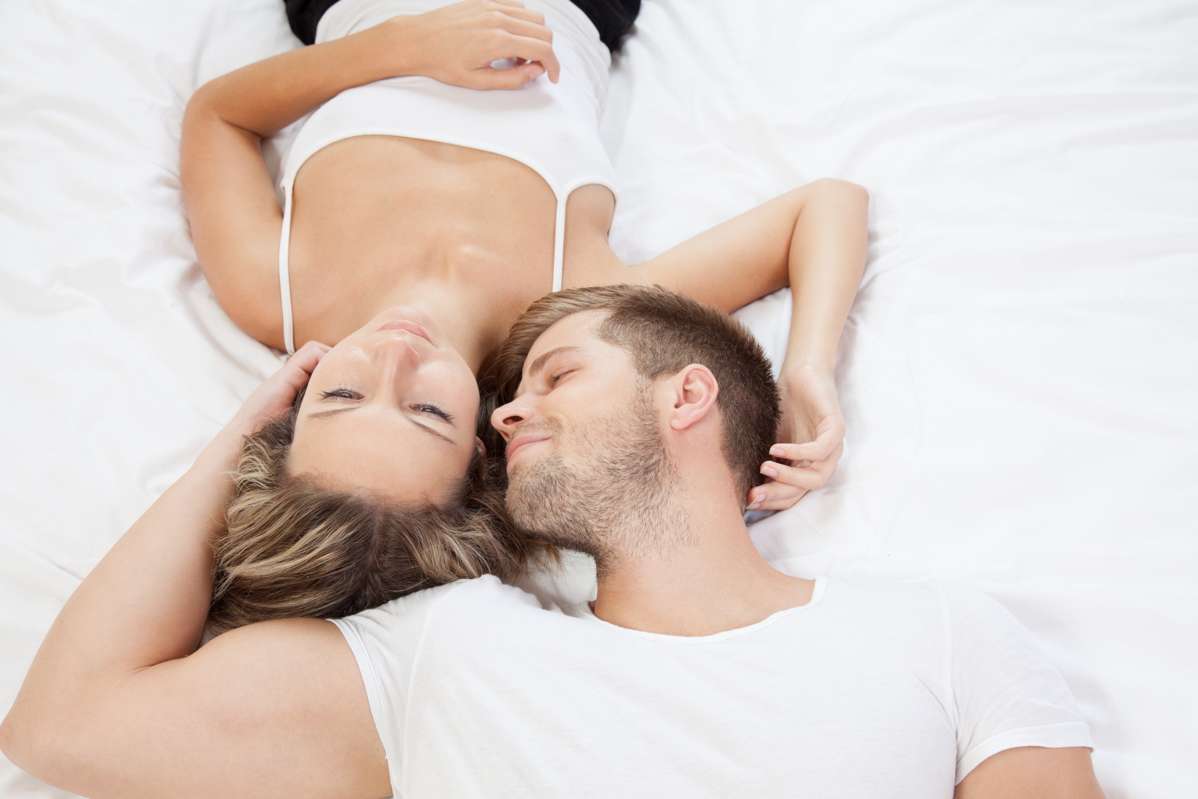 sexless marriage couples lying in bed